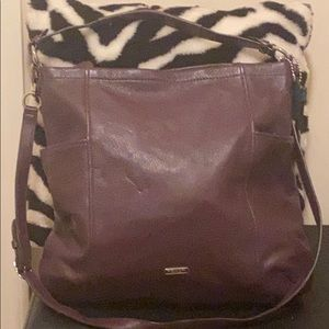 Coach purse w/zipper closure and shoulder strap.